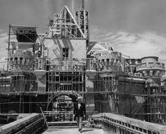 May 1955: Walt in front of Sleeping Beauty's Castle, still under construction. (Amazing how far from completion it is, given the grand opening was only two months away.)