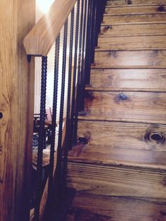 Rebar painted black for railing on rustic stair case!