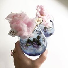 Magical Summer Signature Wedding Cocktail ~ Nectar and Stone's blue curaçao, sprite, lavender essence drink with blueberries + violas, topped with cotton candy and edible metallic glitter stars