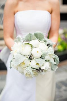A white wedding bouquet with peonies and dusty miller | Brides.com