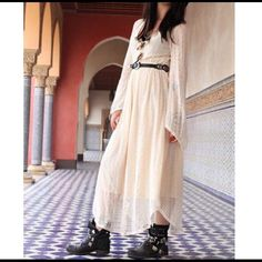 Bohemian Dress Amazingly stunning crochet emboidered cream color dress. Long sleeves end in a bell shape and bottom of skirt also ends in V shape. Elastic band at the waist. Fully lined with a silky cream slip. This dress is absolutely a must have if you are going to an outdoor concert, festival or Coachella. Dresses