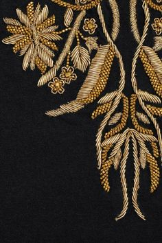 Embellished with gold zardosi embroidery and molten beads, Alexander McQueen's black cotton tank. Zardosi Embroidery, Tambour Embroidery, Couture Embroidery, Types Of Embroidery, Indian Embroidery, Gold Embroidery, Hand Embroidery Designs, Embroidery Stitches, Embroidery Patterns