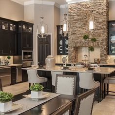 Taupe walls, dark cabinets, stone wall