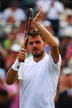 Stan Wawrinka of Switzerland celebrates during his Gentlemen's Singles second round match against Yen-Hsun Lu of Chinese Taipei on day four of the Wimbledon Lawn Tennis Championships at the All England Lawn Tennis and Croquet Club at Wimbledon on June 26, 2014 in London, England. (Photo by Al Bello/Getty Images)