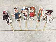 Gravity Falls These adorable cupcake toppers are the perfect addition for your next birthday party or event. They can be used on cupcakes or as food picks on appetizers. You will receive 12 toppers each die cut measuring 2.5 inches tall. Made with acid/lignin free card stock. If