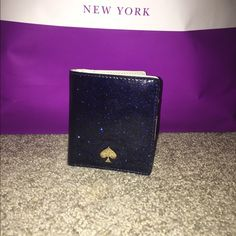 Kate Spade Glitter Bug Small Stacy This is an authentic Kate spade glitter bug small Stacy in navy blue. It's a glitter full leather, almost patent like. It has four handy card slots plus a billfold compartment and an ID window. Has been used, but it in good condition. Small mark (4th pic) by ID slot. kate spade Bags Wallets