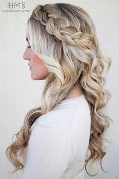 This hairstyle looks positively romantic reminiscent of Grecian hairstyles. These braids with curls can pass for long hair style ideas for weddings and other important events. #hairstyle