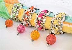 Beaded Soda Tab Napkin Rings - Citrus Sorbet - yellow, hot pink, lime, orange - set of 4 - eco-friendly/upcycled - under 20.00. $20.00, via Etsy.