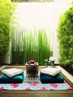 Japanese Style Patio with Bamboo Fence & Cushioned Seating - Really Cool Idea