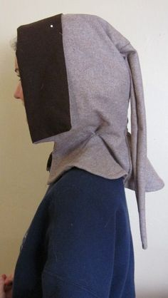 """""""London hood - wool remnant with a partial linen lining. Almost finished, it only lacks buttons and buttonholes. I wish DH had informed me about the funky drape before he took the photo ..."""""""