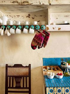 White porcelain, distressed wood cabinets and ethnic tiles are a feature of the open kitchen. Uniquely Indian and charming, designer Sabyasachi Mukherjee's home is an accurate reflection of the person he is