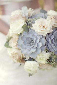 Not only are succulents a popular wedding detail, adding a few to a wedding bouquet can give the perfect touch of hazy blue. The succulents shown here add a rustic vibe to a white bridal bouquet. | 12 Beautiful Blue Wedding Ideas and Details