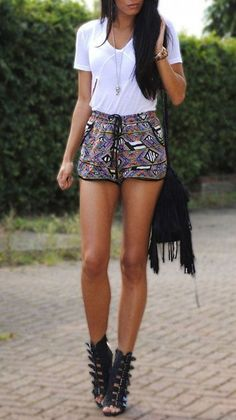 Aztec high waisted shorts with a simple white tee and a long plain necklace, high heel black sandals spikes that go up to the ankle