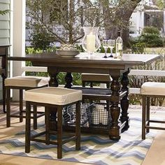 "Counter-height wood dining table with turned legs and an extendable leaf.   Product: Dining tableConstruction Material: WoodColor: Distressed molassesFeatures: Part of the Paula Deen Home CollectionTurned detailingIncludes one 16"" leaf  Dimensions: 37"" H x 44-60"" W x 60"" DNote: Chairs not included"