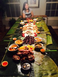 My first boodle fight - rice, baked crispy pata, grilled pork belly, lumpia Shanghai, pork BBQ, longanisa, daing, mango salad, tomatoes with hard-boiled eggs, kimchi jiggae, and banchan.