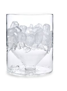 Icicle Ice Bucket - This ingenious glass ice bucket slows the melting of the ice by separating the ice in the upper half of the elegant glass vessel from the slowly accumulating pool of water below. Made of borosilicate glass.