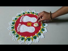 India celebrates many festivals throughout the year. Draw Lakshmi Footprints in Rangoli to Celebrate Gauri Awahan or any India Festival. Rangoli Designs Latest, Simple Rangoli Designs Images, Rangoli Designs Flower, Rangoli Border Designs, Rangoli Patterns, Colorful Rangoli Designs, Rangoli Designs Diwali, Diwali Rangoli, Flower Rangoli