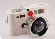 Leica x Lego Art meets analogue meets digital in this fun creation by artist Mr. Using special LEGO pieces, he recreated the Leica camera, complete with viewfinder, shutter button, and. Leica Camera, Camera Gear, Old Cameras, Vintage Cameras, Leica Appareil Photo, Retro, Camera Obscura, Lomography, Mug