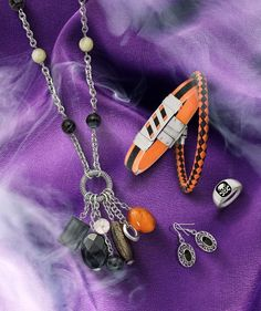 Treat yourself to these orange and black themed styles just in time for Halloween! #QualityGold #SkullJewelry #SkullRing #OrangeandBlackJewelry #HalloweenJewelry #HalloweenStyles