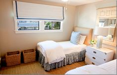 white dresser between twin beds for shared bedroom
