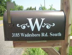 So much nicer than the boring numbers on most mailboxes. I would love to do this with an A.