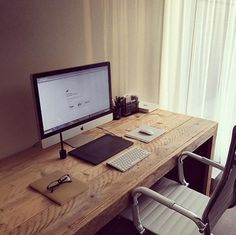wood office. imac technology and salvaged wood office