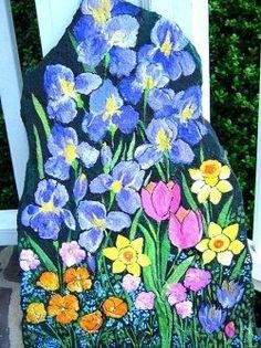 SEE LINK:-  SO MANY Hand Painting Flowers & Fairies on Garden Rocks