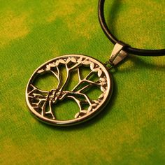 Celtic tree of life jewelry necklace. The pendant is stainless steel and is 28mm across. It is on a 18″ leather cord. It is a reference to Genesis 3:22 to 24.