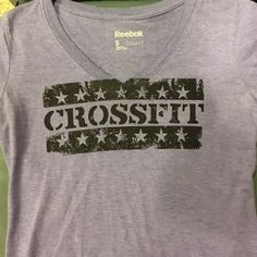 Purple CrossFit tee Purple Reebok CrossFit tee! V-neck hardly worn! Reebok Tops Tees - Short Sleeve