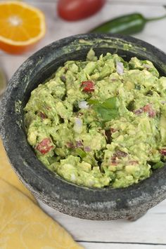 Cinco de Mayo is coming and I'm showing you how to make The Best Homemade Ultimate Guacamole recipe that you'll ever have and it uses fresh orange juice!