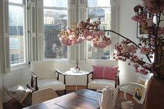 """Too much going on in this room would detract from that million dollar view. The designer only used pink for a """"pop"""" out of """" the drab""""!"""