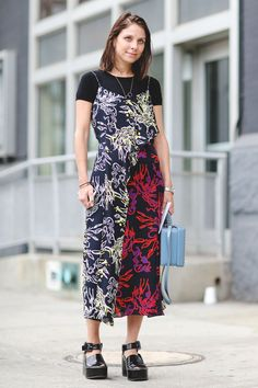 The Most Authentically Inspiring Street Style From New York #refinery29  http://www.refinery29.com/2015/09/93788/ny-fashion-week-spring-2016-street-style-pictures#slide-48  Layer your printed dresses over a black tee for a bit of an edge....