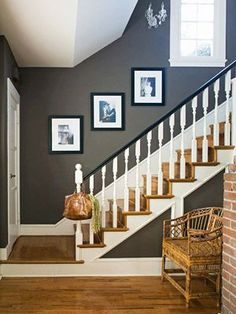 A rich cocoa makes the small entryway seem grand. Black semigloss paint on the railing and accents of crisp white create a bold contrast, one of the keys to livening up a neutral palette.