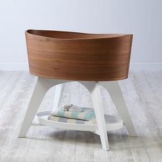 "Our Norse Bassinet features walnut veneer, giving each one stunning, natural wood grain. And the sleek, oval shape of the Scandinavian-inspired design gives it a clean, modern look that'll allow it to fit anywhere in the home. It's one of the few things for your baby that you can actually refer to as ""clean."""