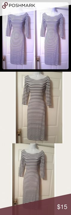 Black&white stripes knit sheath dress Sporty Black&white stripes knit sheath dress with a high round neckline and 3/4 length sleeves . Dress is in beautiful like new condition. Dresses Midi