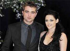 Kristein Stewart, Robert Pattinson get cozy at a party?