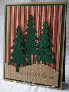 hand crafted card from Christmas Card Challenges: Challenge #33 -- Embossing ... three die cut trees with different embossing folder textures ... simple landscape line and striped paper in warm neutrals ..