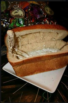 Use a loaf of bread to make an awesome coffin dip holder at a Halloween party!