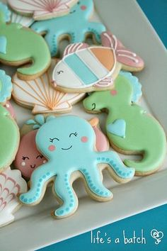 """""""Under the Sea""""-themed cookies, made to custom-match nursery bedding from Carter. """"Under the Sea""""-themed cookies, made to custom-match nursery bedding from Carter's. Summer Cookies, Fancy Cookies, Iced Cookies, Cute Cookies, Royal Icing Cookies, Cookies Et Biscuits, Sweet Cookies, Heart Cookies, Fish Cookies"""