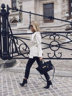 Black And White Blazer Outfit: Mandy Shadforth is wearing a creme jacket with black leather pants and ankle boots