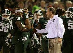 Mark Dantonio and Darqueze Dennard celebrate in the final moments of their 24-20 win over the Stanford Cardinal in the 100th Rose Bowl Game presented by Vizio at the Rose Bowl on January 1, 2014 in Pasadena, California. (Photo by Kevork Djansezian/Getty Images)