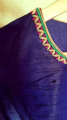 Royal Highness - Striking blue high neck blouse Royal blue : Color Princess cut high neck blouse with multicolored floral hand embroidery for sleeves and neck. Back hooks Brocade Blouse Designs, Kids Blouse Designs, Hand Work Blouse Design, Simple Blouse Designs, Blouse Neck Designs, Churidhar Designs, Simple Embroidery Designs, Kurti Embroidery Design, Hand Embroidery