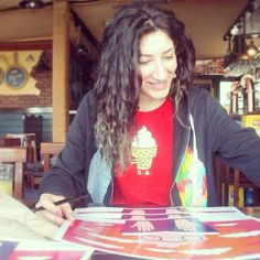 """Here an example of #shy #me while I'm #signing several #copies of my #illustration """"Attraverso"""" made for #Bicicletterario the first and the one #literary #prize in Italy totally dedicated to #bycicle and its #world  #glad to be part of this #beautiful #project #ecology #freedom #bike #feelfree #letteratura #smile #greenhairdontcare  #outfit by #threadless #threadlessaddicted #ilovedoodle by insta_rili"""