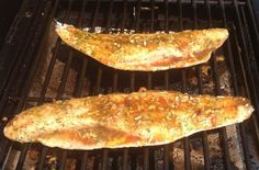 Redfish fillets with scale side down on the grill 1 Tablespoon mince garlic 1 stick of butter 1 lemon...