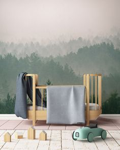 This misty forest wallpaper mural brings a touch of nature and soothing tones to this baby nursery. Nursery Wall Murals, Nursery Paintings, Nursery Themes, Nursery Room, Boys Nursery Wallpaper, Nature Themed Nursery, Boy Room, Nursery Ideas, Woodland Nursery Boy