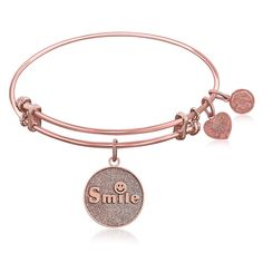 An expandable bangle in pink tone brass. A smile costs nothing, but it can brighten someone's day immeasurably.Specification Bangles Finish: Polished Condition:
