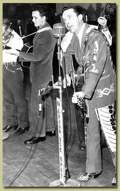RAY PRICE & ROGER MILLER ON STAGE - Ray Price performs on Grand Ole Opry - Nashville, TN - That's Roger Miller in the suit with guitar.  Miller was a member of Price's Cherokee Cowboys band at the time.
