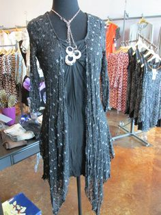 SZ: S-XL $66  ADORABLE Tunic!! Black with Silver accents!! Looks like 2 pieces but it is ONE! This tunic will look great with leggings or can even be worn as a dress!