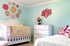 Fabric hoop gallery wall over the crib - such a sweet touch in this aqua nursery!