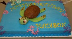 Sea turtle birthday cake.  Turtle body and head is made from rice krispies covered with fondant.  Flappers are fondant.